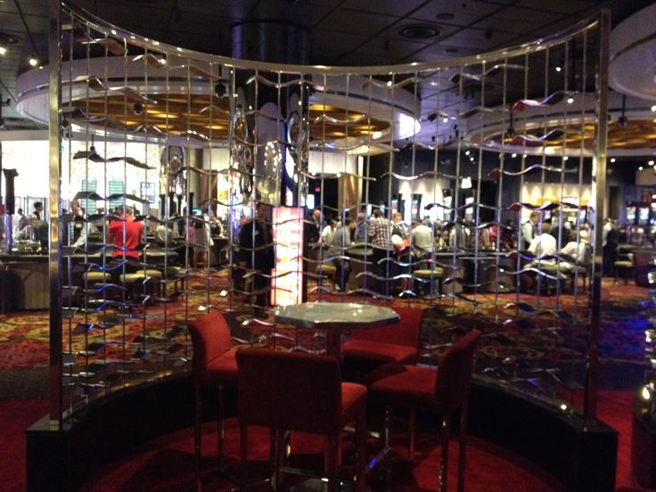 PHOTO 11 Velvet Bar: Curved metal artwork is effective in separating bar from gaming area.