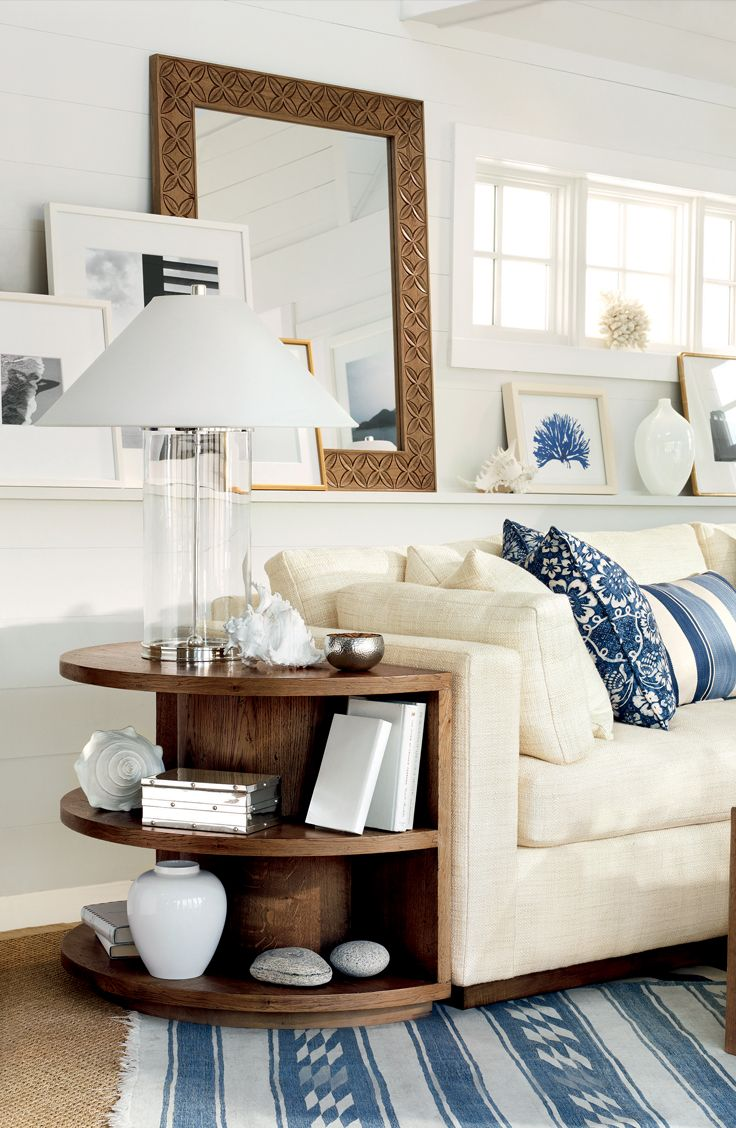Ralph Lauren Home's Driftwood Sofa and nautical decor transform a living rom into a soothing retreat by the ocean - LOVING THE END TABLE