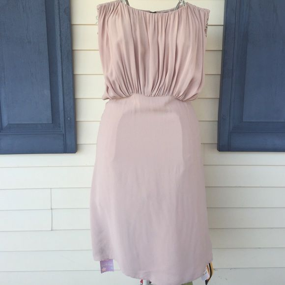 "NWOT L'AGENCE Cocktail Dress Beautiful sleeveless dress with a sexy opening in the back. Perfect for any occasion. Shelf 100% viscose, lining 100% polyester. Fully lined. This dress is 40"" long. This dress is not really a cream color; its more like a cross between pink and peach. Pictures show the true color. A couple of very small pulls shown in last picture not very noticeable. L'AGENCE Dresses Midi"