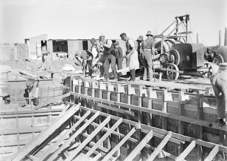 Pouring concrete for the walls, Manuka Pool, 1930.    Photographer: William James Mildenhall. NAA: A3560, 6422