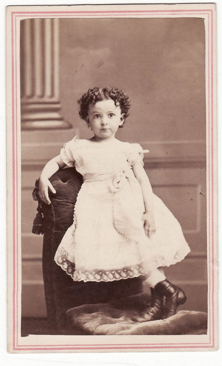 +~+~ Antique Photograph ~+~+   Impish girl with curls.