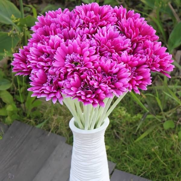 Description:  10Pcs Sunbeam Artificial Flowers Gerber Daisy Bridal Bouquet Silk Wedding Party Flowers  Specification:  Material: Silk  Color: Rose red, Yellow, Pink, Purple, Red, Orange, White, Green  Size: total length 55cm, branch: 49mm  Flower Dia.: 10cm  Package...