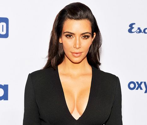 Kim Kardashian Reveals Why She No Longer Smiles in Photos - Us Weekly