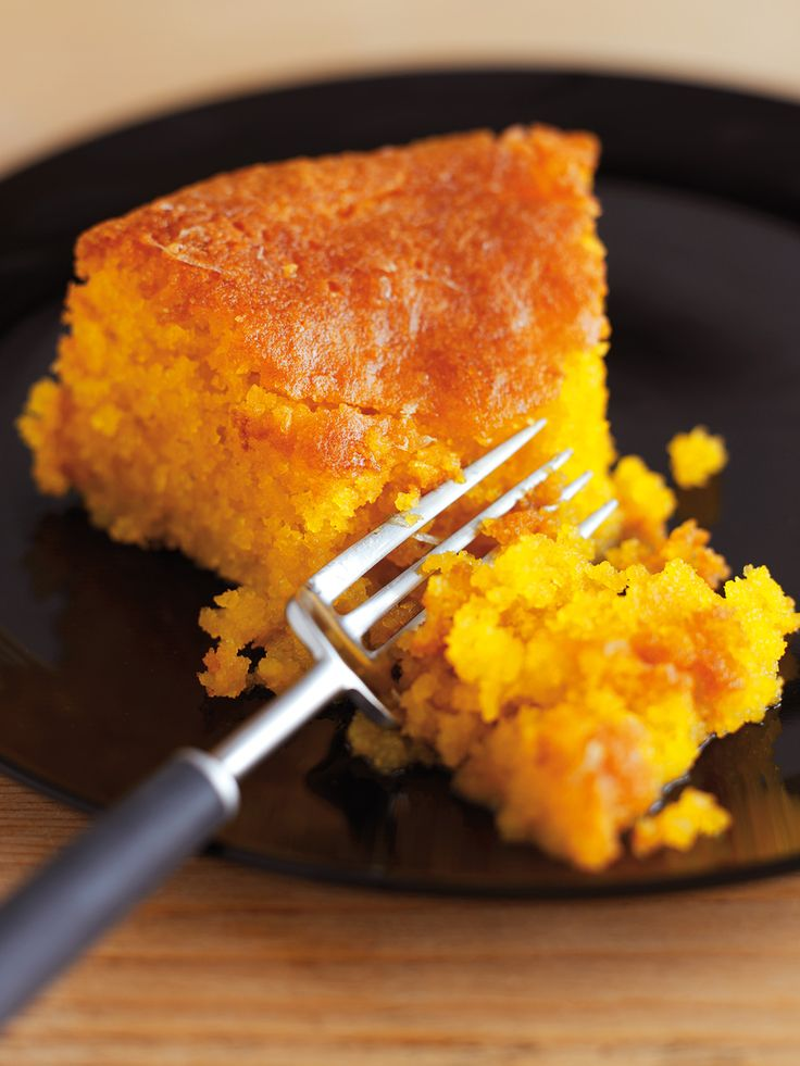 This cake is a sort of Anglo-Italian amalgam. The flat, plain disc is reminiscent of the confections that sit geometrically arranged in patisserie windows in Italy; the sharp, syrupy sogginess borrows from the classic English teatime favourite, the lemon drizzle cake. It is a good marriage: I love Italian cooking in all respects save one - I find their cakes both too dry and too sweet. Here, though, the flavoursome grittiness of the polenta and tender rubble of ground almonds provide so much…