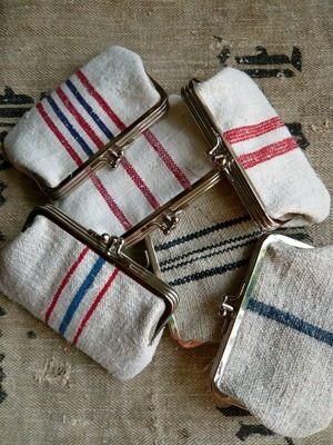 Small purse made with Hungarian Grain sack fabric.100% cotton lining.2 compartment, silver coloured snap frame closure.Dimensions 14cm/9cmWill fit credit cards