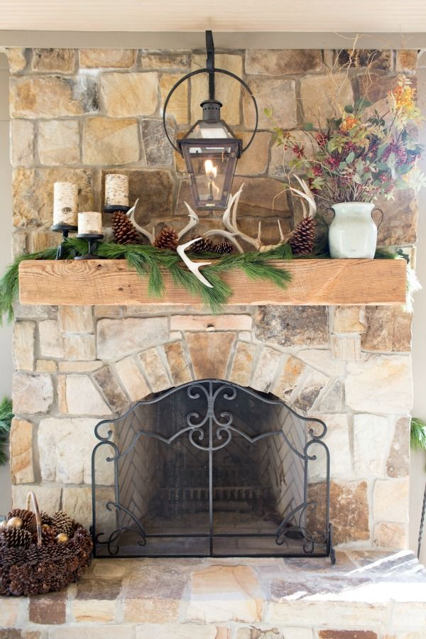 Outdoor Fireplace and decorated mantel: Pinecones, fresh greenery, candles and seasonal blooms