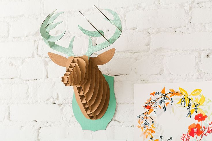 Use recycled cardboard to make this deer head decoration.