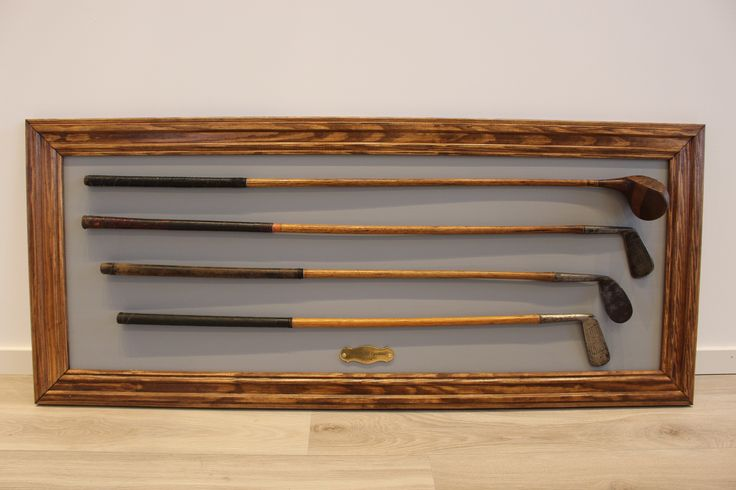 Custom golf club display - Made by LexLektor  The background is coloured matt grey, while the sides are antique Brown, coated With varnish. All Clubs are fixed With steel wire. Check out my DIY-blog at: https://lexlektor.wordpress.com/2015/03/09/golf-club-display-custom-work/