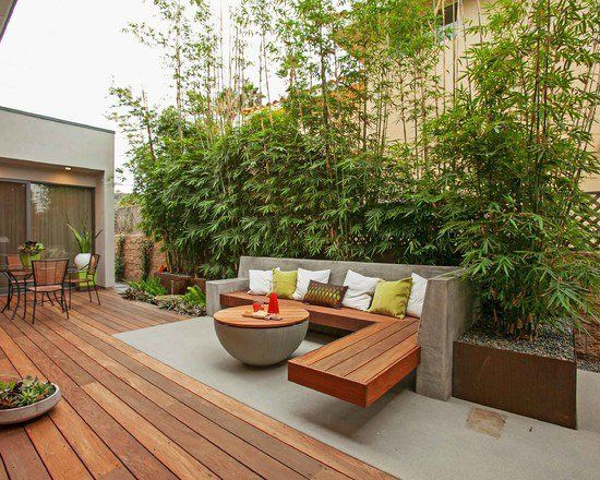 beautiful modern deck design with wood and concrete dining and coffee area