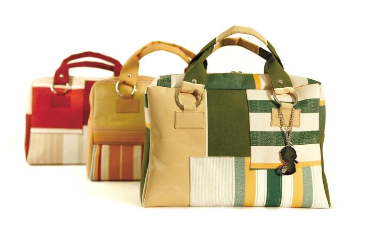 Eli Mundo briefcase,  Made with recycling materials.  Tres bolsos maletín de Eli Mundo  Hechos con material reciclado.