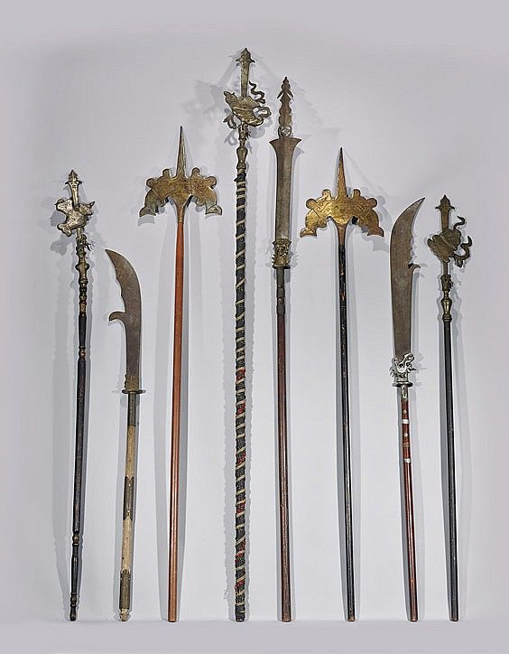 """EIGHT VINTAGE/ANTIQUE CHINESE WEAPONS Collection of eight various vintage/antique Chinese polearm weapons/standards; several with Buddhist emblems and dragon heads, with bronze and iron ornamentation; H: 98"""" (tallest); Provenance: Formerly in a collection of Armand J. Labbe, curator with the Bowers Museum; by repute collected after the Boxer Rebellion Circa 1900;"""