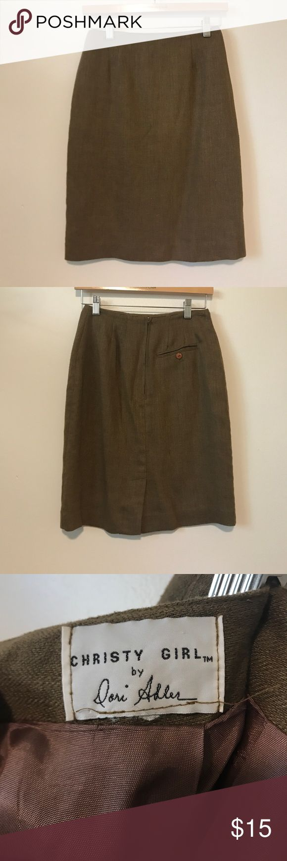"""Vintage wool khaki pencil skirt Vintage pencil skirt from """"Christy Girl by Dori Adler"""". Fabric is a khaki, greenish color with a herringbone pattern. Single buttoned pocket in the back. High waisted, hits just above the knee. In excellent used condition. Very slight pilling around the seam (see last picture) Zips up the back. Size tag was cut out, fits like a small (2). Vintage Skirts Pencil"""