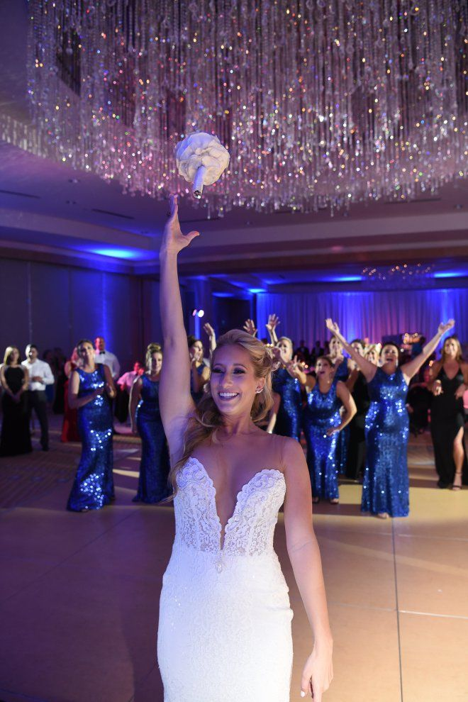 "Must Have Wedding Photos BOUQUET TOSS Florida Wedding Planner  -Unique Design Studios-   Do you already have a mental list of the photos your photographer ""must take"" at your wedding? You know... that picture of your veiling blowing in the wind, the tears in your father's eyes as he sees his daughter, the photos of your bridesmaids popping a bottle of champagne, or the moment when your groom first sees you walk down the aisle. Here are some ""must have"" wedding photos."