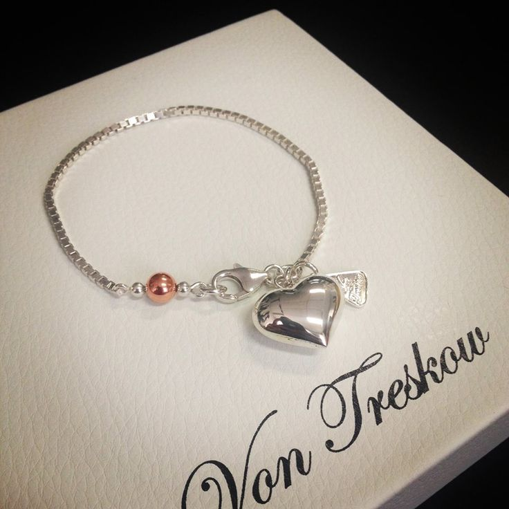 Fine sterling silver box chain bracelet with a splash of rose gold
