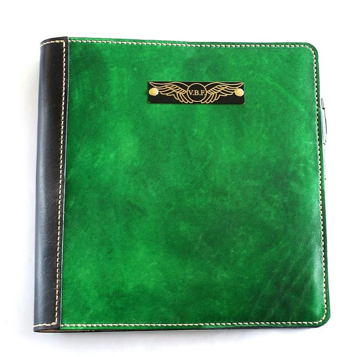 Deluxe Green & Glack pilot logbook cover with initals / wings plate in black on brass and with bone stitching. 100% genuine leather, hand dyed, hand stitched. Hand made to measure international pilot logs. Options include snap closure, penholder and credit card sized licence pocket. Range of hand dyed leather colours.FREE overseas shipping on some orders.