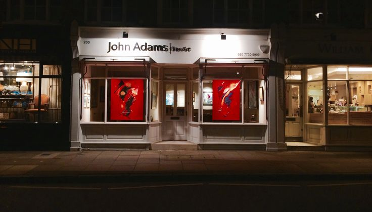 An image of our current window display at John Adams Fine Art by night. Paintings by contemporary French artist Jean Soyer.  For more information about Soyer and his work please visit our website.
