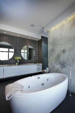 Riverstone's Palais - Master Ensuite with freestanding spa, amazing lit feature stone wall and round mirrors over the luxurious vanity