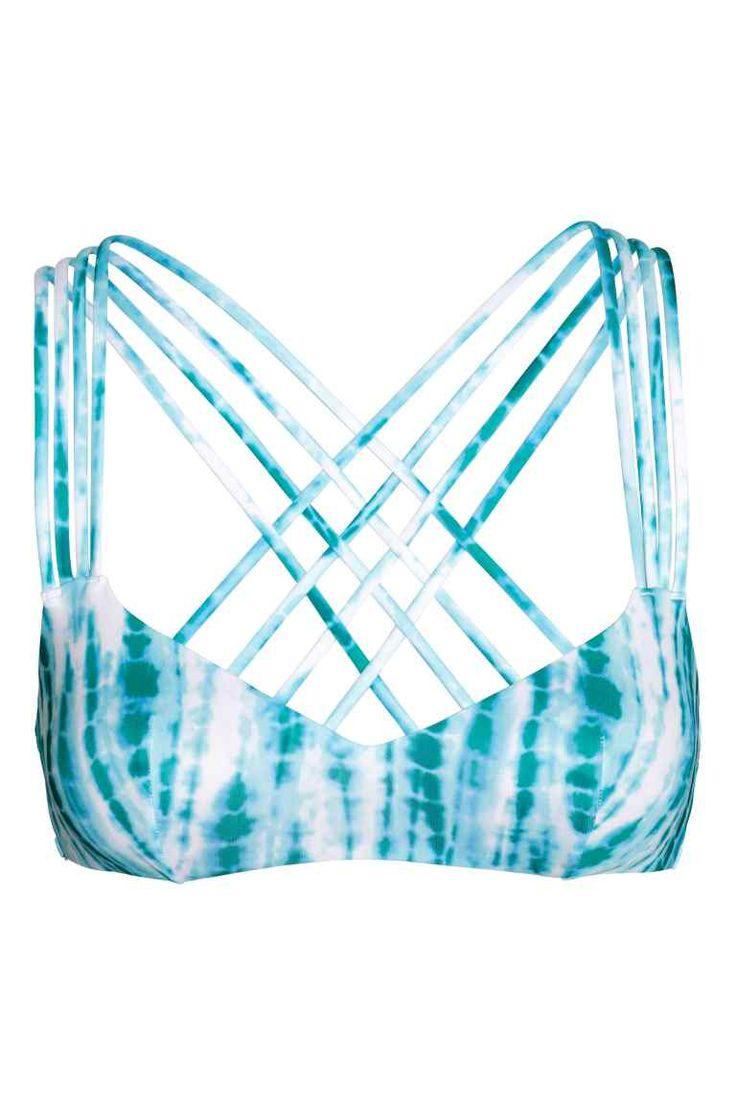 Top de biquíni bandeau: Top de biquíni forrado com quatro alças entrançadas atrás e almofadas removíveis. Sem fechos.