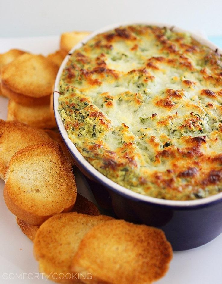 Hot Cheesy Spinach-Artichoke Dip – Super easy, cheesy dip that pairs perfectly with toasty baguettes, crackers and pretzels!   thecomfortofcooking.com