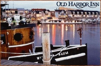 """Old Harbor Inn, South Haven, Michigan. Exceptional waterfront hotel has spacious individually appointed rooms with incredible harbor views. Located downtown, walk the beaches, shopping, restaurants, parks, nightlife and more. All rooms include kitchenettes, free wireless and cable; many with private balconies; Jacuzzis and fireplaces. Indoor pool and hot tub. Complete conference facilities. Outstanding """"Quiet Season"""" values."""