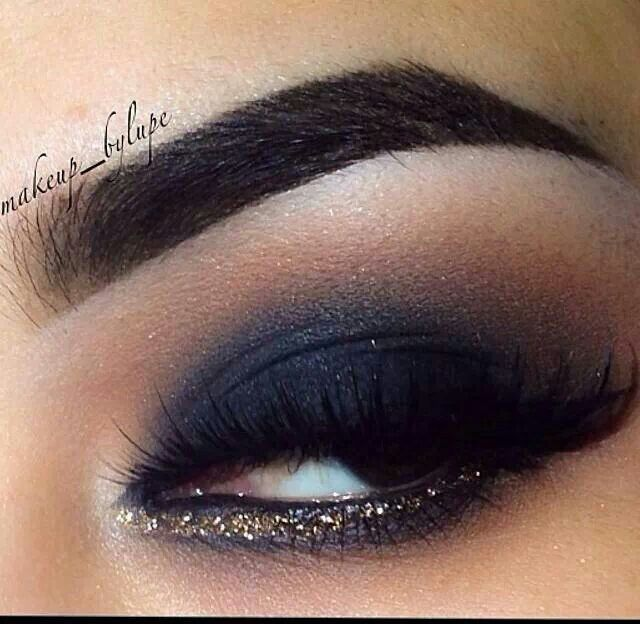Navy eyeshadow, gold eyeliner