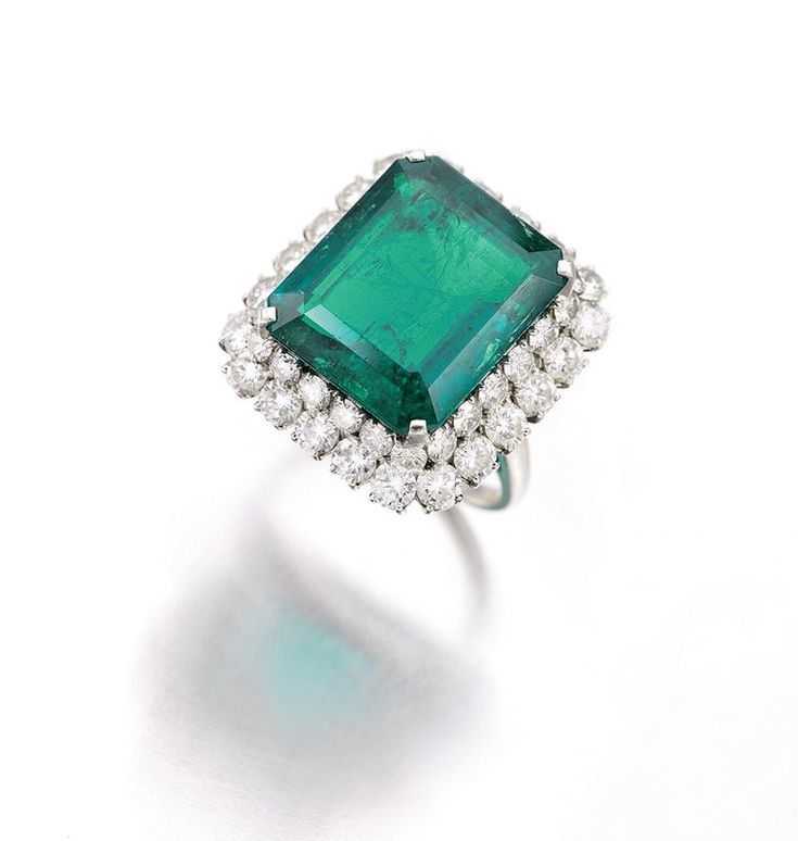 An emerald and diamond ring by Bulgari belonging to Gina Lollobrigida, circa 1964, set with a step-cut emerald weighing 16.62ct and framed by two rows of brilliant-cut diamonds. Discover the history of Bvlgari: http://www.thejewelleryeditor.com/jewellery/bulgari-history-of-style-celebrities-iconic-design/ #jewelry