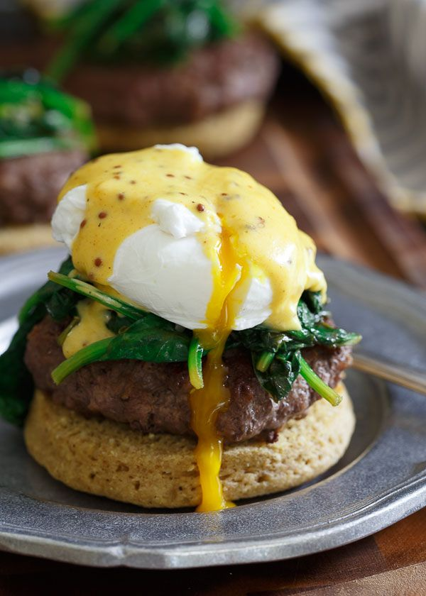Open Faced Burger Benedict. This recipe takes the famous eggs benedict to a whole new level with a juicy burger and easy blender hollandaise sauce. Served on a paleo english muffin it's grain free too!