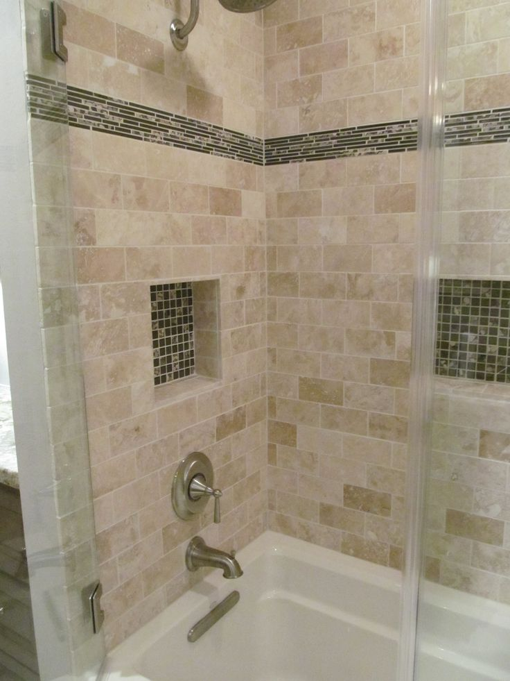 The shower surround is a travertine tile the accent tile for Travertine accent tile