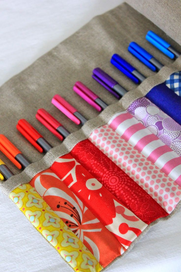 Great idea also for Crochet hooks and or Knitting needles. and a perfect scrap fabric DIY project.  I need a few of these.