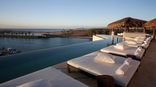 Sunlounges at the Hotel El Ganzo look out over a pool to the Sea of Cortez.