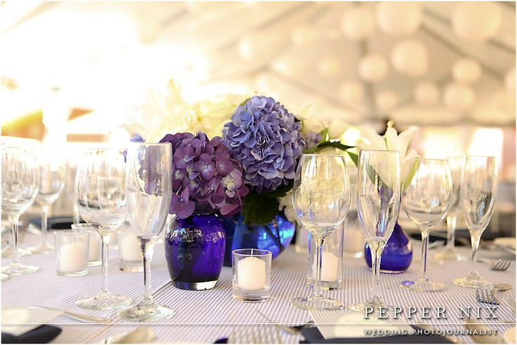 Purple hydrangea centerpieces in blue vases for wedding reception