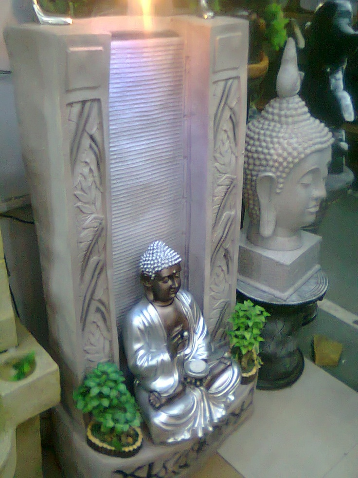 Exclusive Hand Crafted  Fountain of Mahatma Buddha  with Slit water fall. Made of Fiber Stone with Hand  painting. available at TCG 344 FF  Supertech Shopprix Mall Sec  61 Noida 201301 U.P. India Ph.  91-9811119866, 91-9718999053,  91-9718999074  tcggifts@gmail.com,  www.tcgonlinestore.com