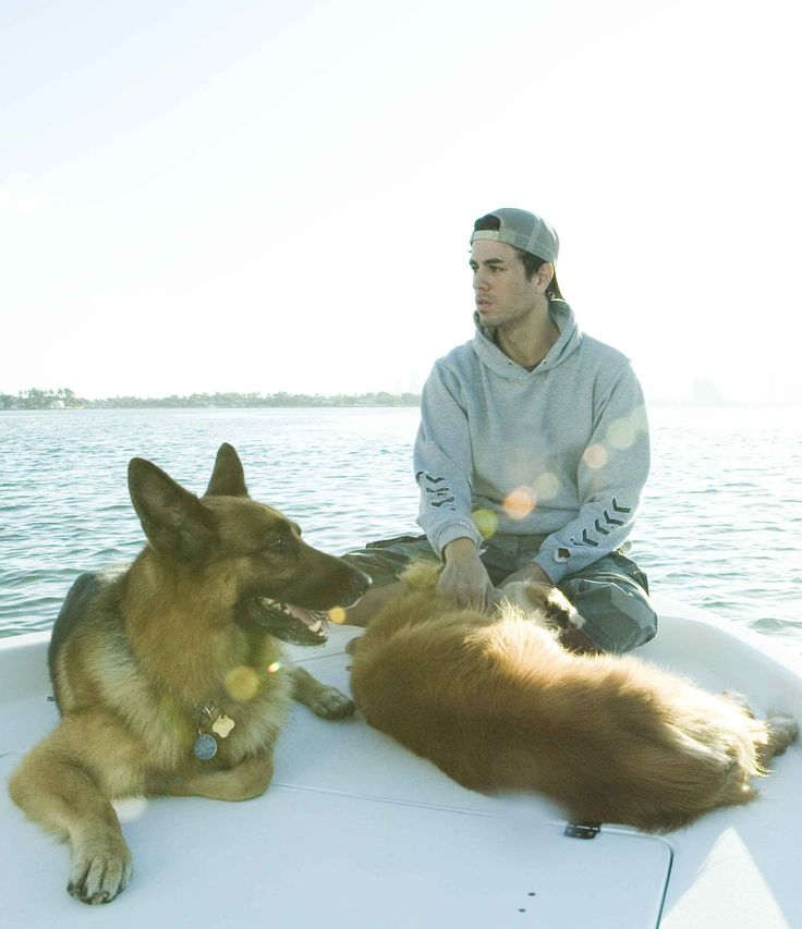 Enrique Iglesias and his dogs Lucas and Grammy