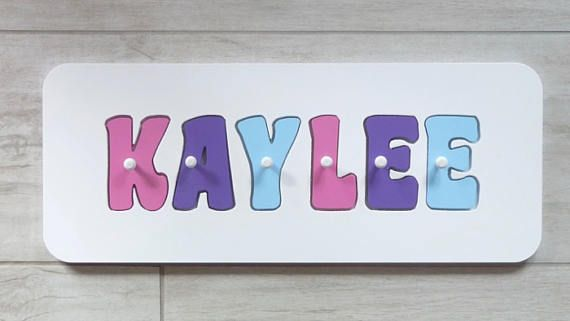 Kids wooden puzzles personalised with their name are a fantastic way to teach your child to recognise their name, help develop fine motor skills and learn colours. When your child has out grown their wooden name puzzle, use it as a name sign and display it on a shelf in their bedroom. Kids wooden name puzzles make a wonderful personalised baby gift for first birthdays and christenings. Can be used as a wooden toy or as decoration in your childs nursery.  Every personalised name puzzle is…
