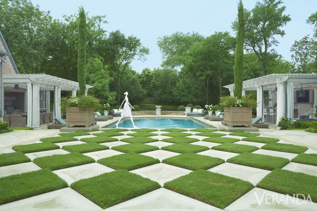 A checkerboard lawn leads to the pool chaises in for Checkerboard garden designs