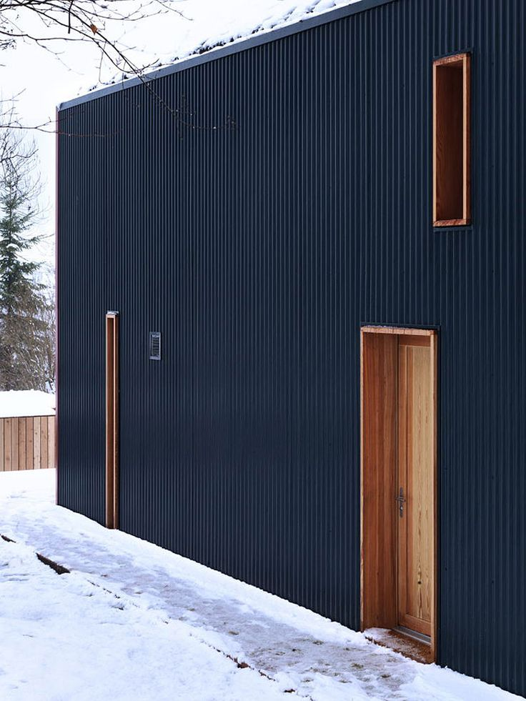 Stripped Black Vallee de Joux Designed with Square Shaped and Flat Roof with Wooden Ventilation and Entrance