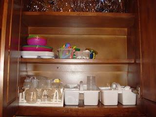organized baby bottle cabinet