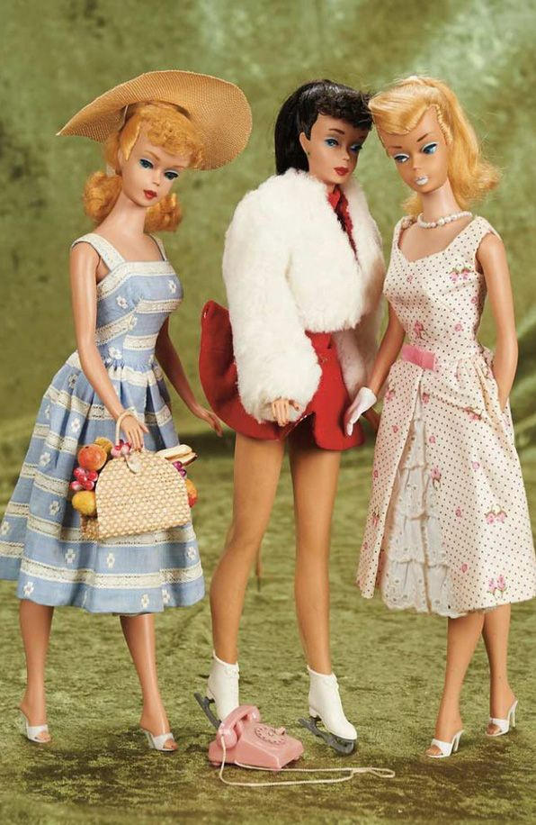 3 vintage Barbie ponytails. Remember a cousin having the blue dress Barbie and outfit