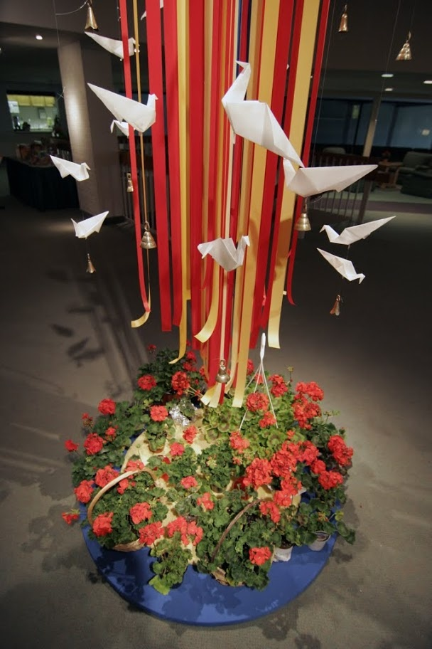Doves, bells, red ribbons, and flowers-all symbols of ...