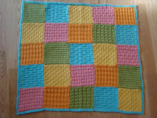 A blanket made from knitted squares