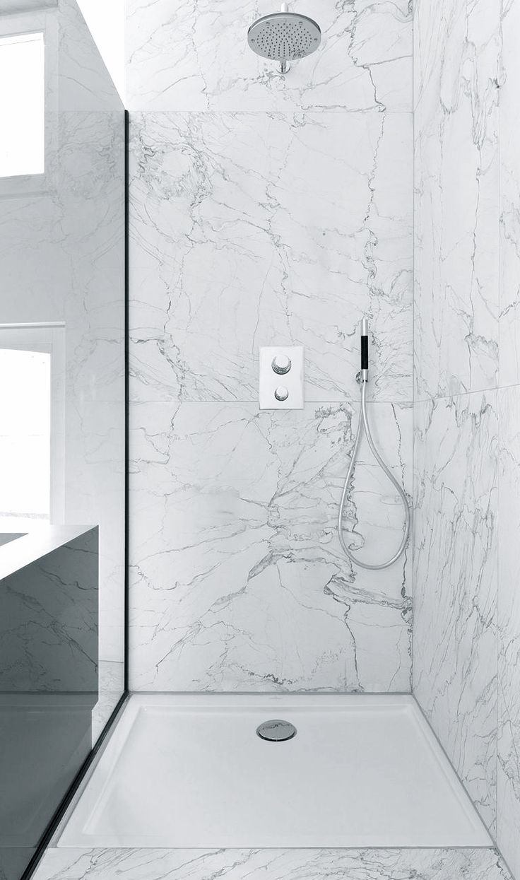 Like the idea of the very large marble tiles - less grouting, plus the preformed shower tray is a practical solution to insisting on a traditional wet-room floor.