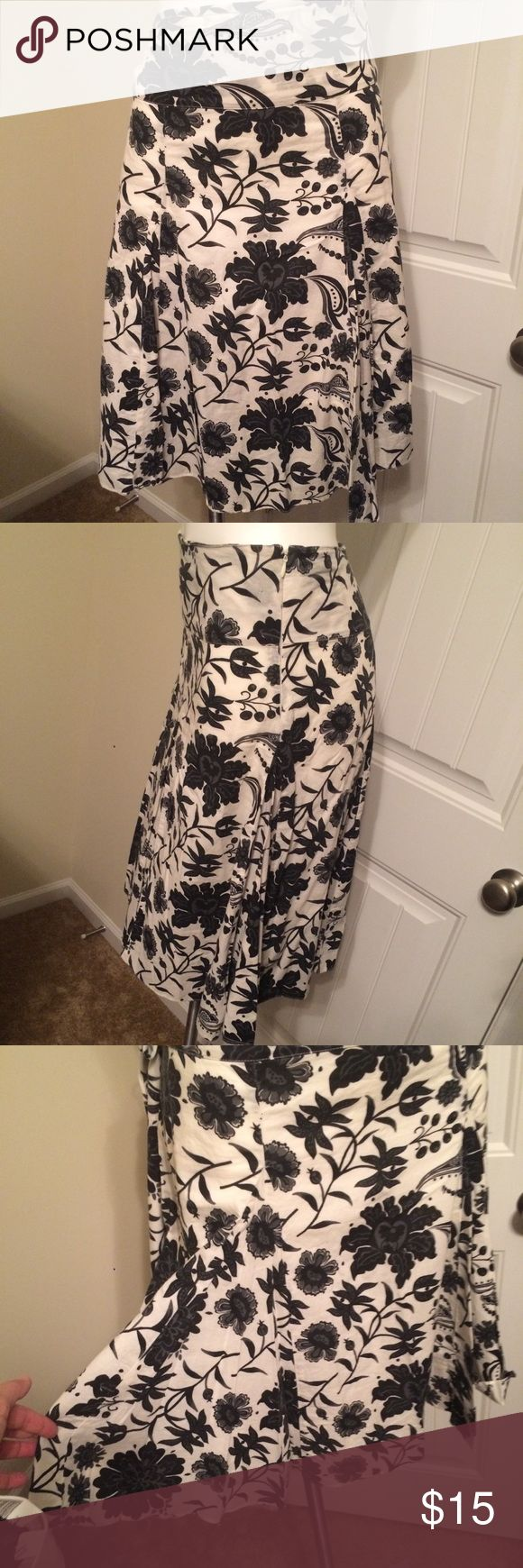 Floral, godet/pleat skirt One of my favorites!!! I can't wear it anymore.  Gently worn & laundered. Still has lots of life left in her!!!  It's a cotton (looks like quality linen), very lightweight & summery. Has a privacy lining underneath. Wide waste band can be worn high or low. Side zip.  Cream base with big black flowers. Skirts A-Line or Full