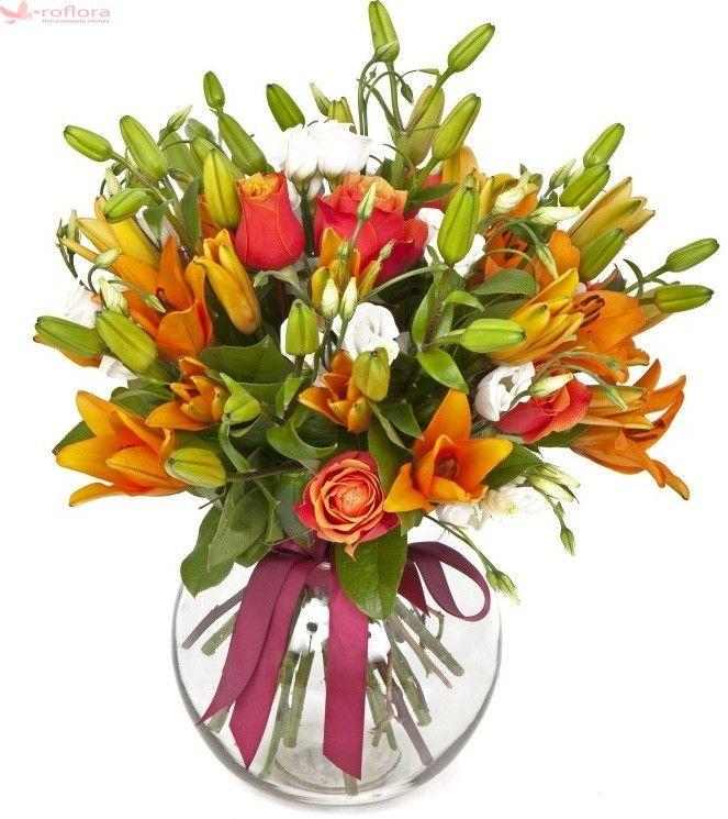 Buchet de flori proaspete ce contine trandafiri portocalii, crini portocalii, eustoma albe. Este livrat in aceeasi zi de un florar local cu experienta, partener Roflora.