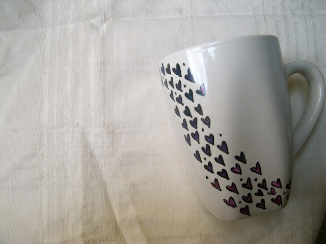DIY decorated mugs.  She used plain white mugs as the dollar store then decorated them with sharpies and baked them at 350 for 20-30 minutes.