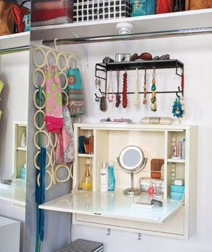 An Ikea laptop workstation can be transformed into a foldaway vanity in the closet.