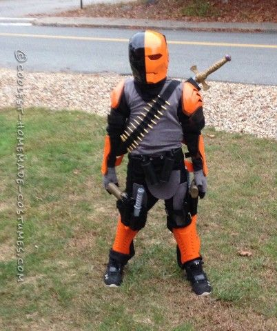 Here's our very own Deathstroke costume. The mask was made from an Iron Man mask. I just used bondo on the part in the middle then sanded it down and...