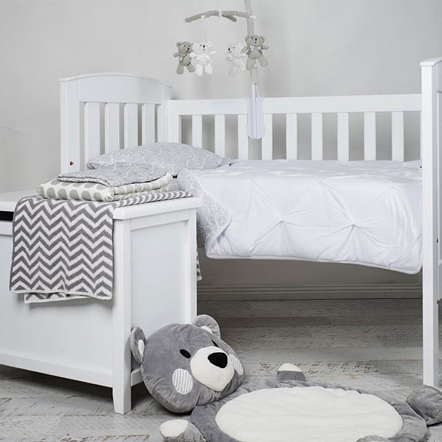 Grey + White Nursery Inspo featuring Tasman Eco Siena Cot + Toy Box and Living Textiles Pintuck Comforter in Grey Paisley + Grey Bear Musical Mobile