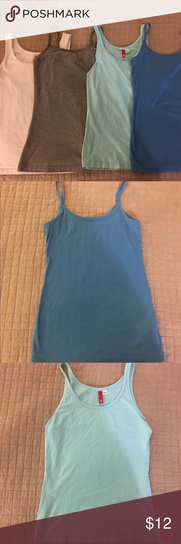 4 Piece Lot Womens Tanks Hey ladies! Here's a special deal just for you!  White tank (small) with built in shelf bra.  Extra stretchy and nice thicker material. Gray tank (large) double layer compression to hide and smooth any lumps or bumps.  Light turquoise (medium) tank. Blue Banana Republic (medium).  All tanks roughly same dimensions when stacked.  Be sure to check back often as I'll be posting a ton of stuff over the next few weeks! Tops Tank Tops