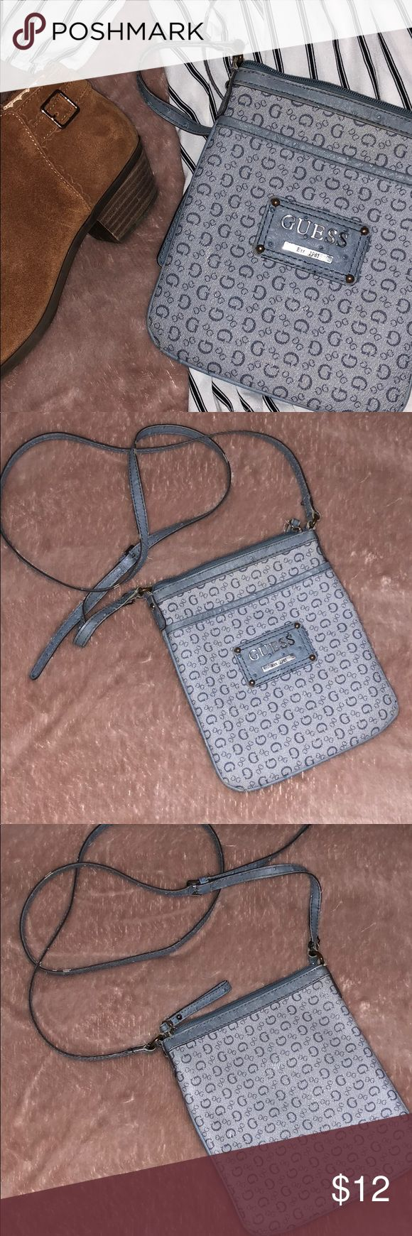 Guess Crossbody - Periwinkle Cute cross body used a few times. GREAT condition. Goes perfect with any outfit! Originally $65, selling for $12 Guess Bags Crossbody Bags