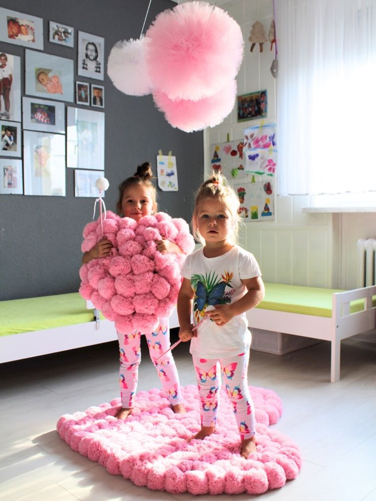 Heart shaped decoration made of most fluffy pom poms: rug and pillow. Tulle pom poms over girls head!